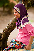 """Sept. 27, 2009 --RANGAE, THAILAND: A Thai Muslim girl near her family home in Rangae, Narathiwat, Thailand. Thailand's three southern most provinces; Yala, Pattani and Narathiwat are often called """"restive"""" and a decades long Muslim insurgency has gained traction recently. Nearly 4,000 people have been killed since 2004. The three southern provinces are under emergency control and there are more than 60,000 Thai military, police and paramilitary militia forces trying to keep the peace battling insurgents who favor car bombs and assassination.   Photo by Jack Kurtz / ZUMA Press"""