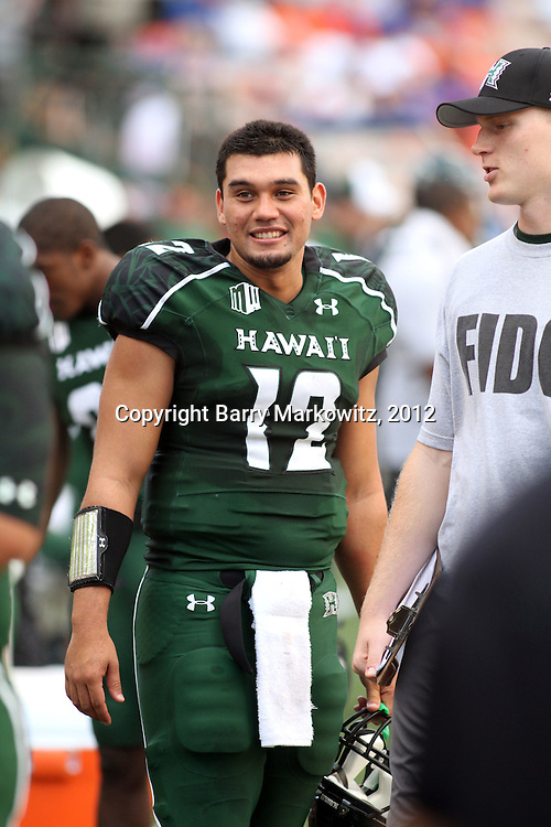 UH reserve QB, Jeremy Higgins, is reserve no more.  UH Head Coach Norm Chow announced post game that competition for the starting QB position is now officially reopened.  Jeremy is connected to the Tuia and other prominent families in the Territory.  Boise State University defeated the University of Hawaii 49-14 at Aloha Stadium.  Photo by Barry Markowitz, 1/10/12, 3pm