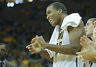 December 04 2010: Iowa Hawkeyes forward Jarryd Cole (50) claps and smiles after a score during the second half of their NCAA basketball game at Carver-Hawkeye Arena in Iowa City, Iowa on December 4, 2010. Iowa won 70-53.