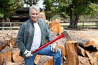 Portrait of senior lumber jack holding an axe