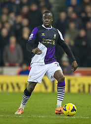 STOKE-ON-TRENT, ENGLAND - Sunday, January 12, 2014: Liverpool's Aly Cissokho in action against Stoke City during the Premiership match at the Britannia Stadium. (Pic by David Rawcliffe/Propaganda)