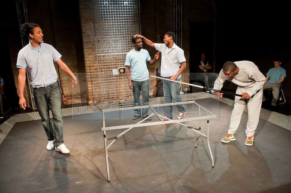 """© Copyright licensed to London News Pictures. 12/11/2010. """"Inside"""" by Philip Osment, presented by Playing Out at the Roundhouse, Camden, London. Based on the real experiences of young fathers in prison, the play deals with big questions surrounding relationships, both with their own fathers and with their children. L to R: Kyle Thorne, Michael Amaning, Darren Douglas, Ayo Bodunrin."""