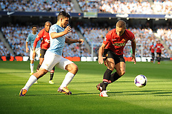 Manchester City's Sergio Aguero takes on Manchester United's Nemanja Vidic - Photo mandatory by-line: Dougie Allward/JMP - Tel: Mobile: 07966 386802 22/09/2013 - SPORT - FOOTBALL - City of Manchester Stadium - Manchester - Manchester City V Manchester United - Barclays Premier League