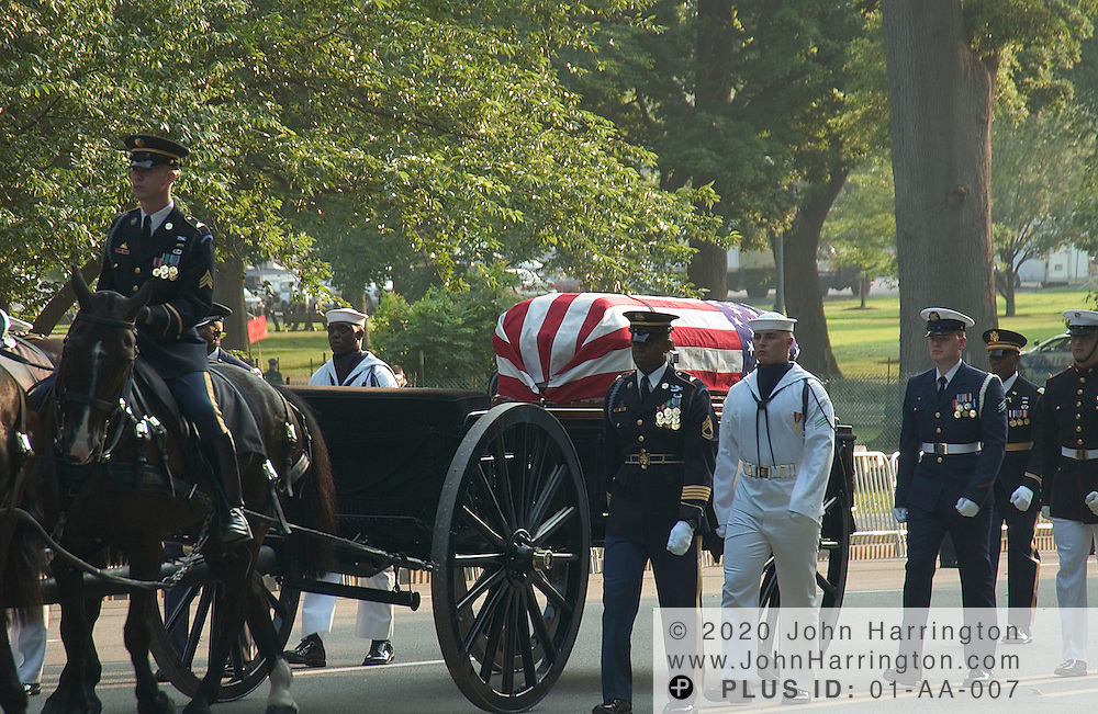 The casson of former President of the United States, Ronald Reagan is escorted from Andrews Air Force base to Capitol Hill on Wednesday June 9, 2004.