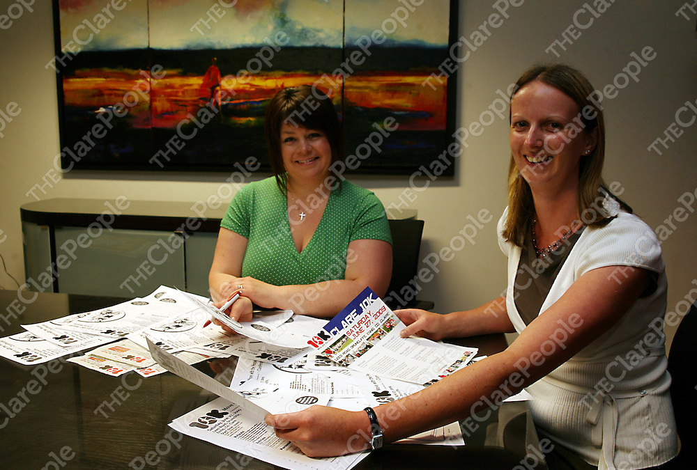 Co-ordinator Orla Ryan with registrar Carmel Brady going through entry forms for this years Clare 10K Move with the People which is on this coming Saturday.<br /> Photograph by Yvonne Vaughan