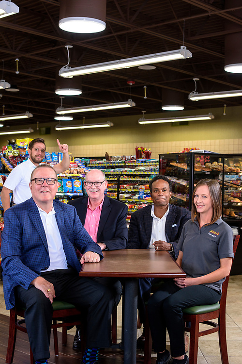 Annville, Pennsylvania - June 28, 2017: Rutters Executives (L-R) Scott Hartman, CEO, Jere Matthews, VP of operations, Derek Gaskins, Chief Customer Officer, and store manager Mindy Torney at the Rutters in Annville, Pennsylvania, Wednesday, June 28, 2017. Scott's son Chris Hartman photo bombs the shoot. Rutters received the highest vote for cleanliness in CSP's Mystery Shop report card.<br /> <br /> CREDIT: Matt Roth