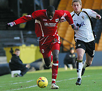 Photo: Paul Thomas.<br /> Port Vale v Bristol City. Coca Cola League 1. 17/12/2005.<br /> <br /> Bristol's Bas Savage gets past Craig James.