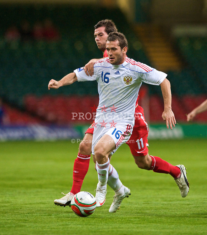 CARDIFF, WALES - Wednesday, September 9, 2009: Wales' Joe Ledley and Russia's Alexander Kerzhakov during the FIFA World Cup Qualifying Group 3 match at the Millennium Stadium. (Photo by Dave Kendall/Propaganda)
