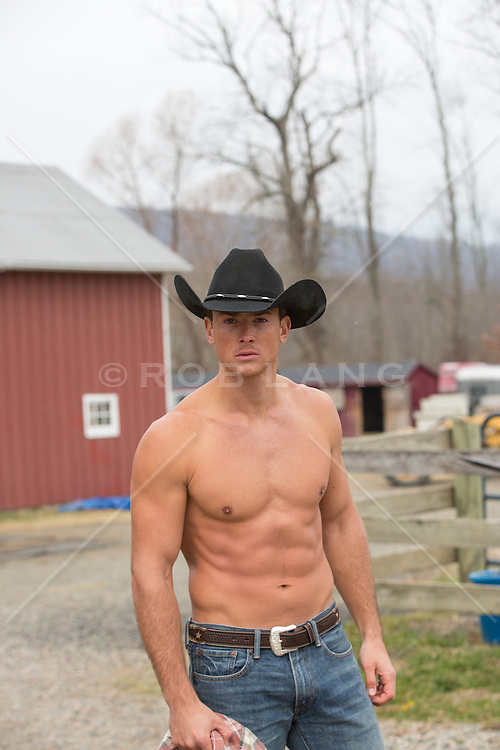 Shirtless muscular cowboy outdoors