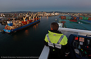 Dave McCloy, San Francisco Bar Pilot, pilots the XIN FEI ZHOU container ship from Oakland 57 to sea