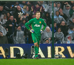 MANCHESTER, ENGLAND - Sunday, January 8, 2012: Manchester United's goalkeeper Anders Lindegaard looks dejected as 10-man Manchester City score the second goal during the FA Cup 3rd Round match at the City of Manchester Stadium. (Pic by David Rawcliffe/Propaganda)