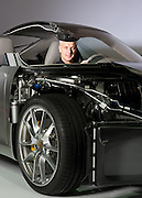 Porsche CEO Matthias Muller sits in partially deconstructed model of the new Porsche Carrera S at the Central Coast Jet Center at the Santa Maria Airport in Santa Maria, Calif., on Thursday, Nov. 10, 2011.