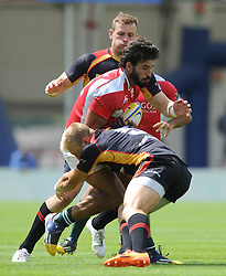 Goncalo Foro of Portugal is challenged from the front by Sebastian Fromm of Germany - Photo mandatory by-line: Dougie Allward/JMP - Mobile: 07966 386802 - 11/07/2015 - SPORT - Rugby - Exeter - Sandy Park - European Grand Prix 7s