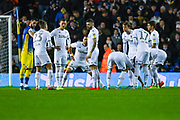 Leeds United players huddle during the EFL Sky Bet Championship match between Leeds United and Hull City at Elland Road, Leeds, England on 10 December 2019.