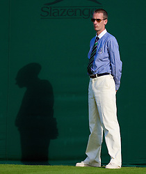 LONDON, ENGLAND - Monday, June 23, 2008: A Wimbledon line judge during day one of the Wimbledon Lawn Tennis Championships at the All England Lawn Tennis and Croquet Club. (Photo by David Rawcliffe/Propaganda)