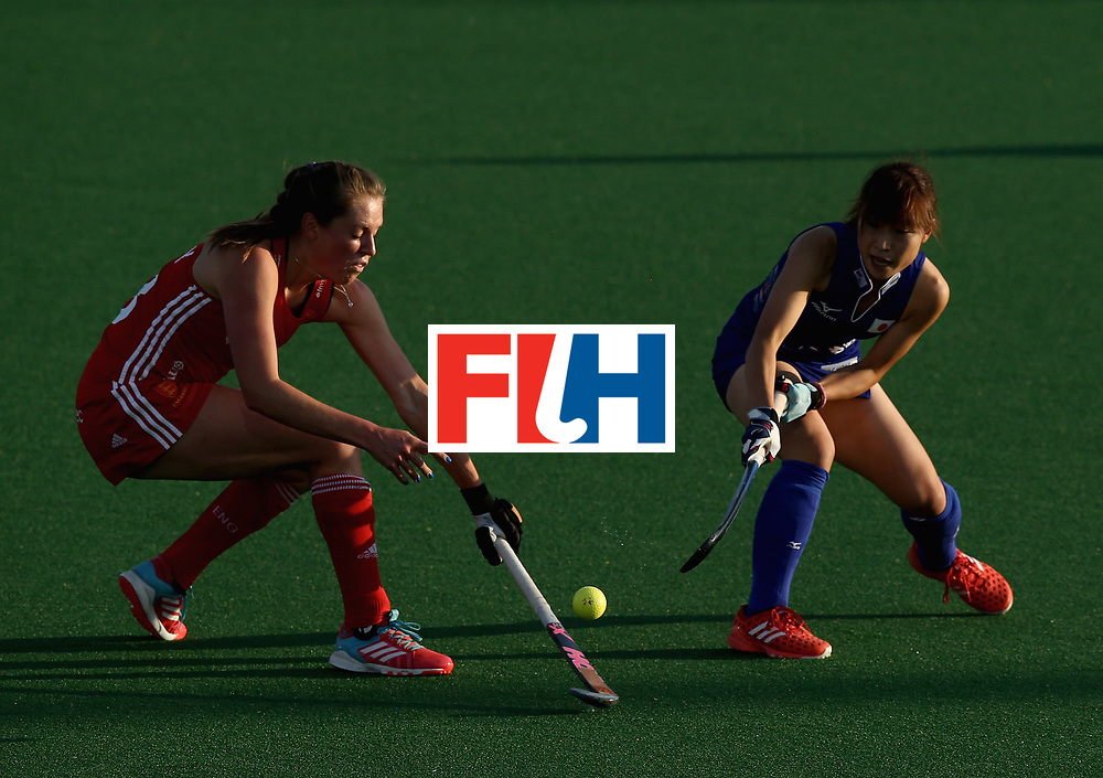 JOHANNESBURG, SOUTH AFRICA - JULY 12: Giselle Ansley of England and Minami Shimizu of Japan battle for possession during day 3 of the FIH Hockey World League Semi Finals Pool A match between Japan and England at Wits University on July 12, 2017 in Johannesburg, South Africa. (Photo by Jan Kruger/Getty Images for FIH)