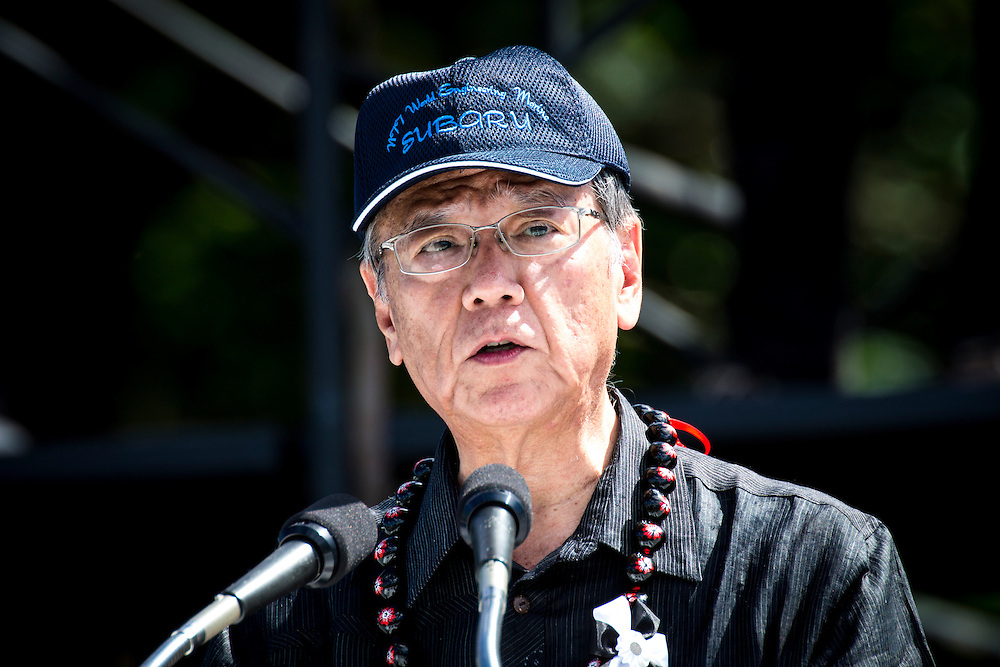 OKINAWA, JAPAN - JUNE 19 : Okinawa Gov. Takeshi Onaga speak in the stage during the Anti-U.S. airbase demonstration and protest against the U.S. Airbase relocation to Henoko at Ohnoyama General Athletic Field at the Ohnoyoma Park and Sports Complex in central Naha, Okinawa on June 19, 2016. Around 65,000 people gathered at the rally. Protests over the US military presence in Japan have grown more intense over past days due to previous incidents including the alleged rape of a Japanese woman and drunk driving in Okinawa by American military personnel.<br /> <br /> Photo: Richard Atrero de Guzman