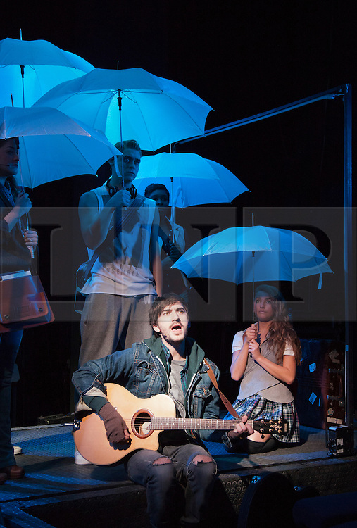 "© Licensed to London News Pictures. 31/01/2013. London, England. At front: George Maguire as ""Busker"". LIFT, world premiere of a new musical by Craig Adams and Ian Watson about love, life and loss in a London lift. Cast includes: Julie Atherton, Nikki Davis-Jones, Cynthia Erivo, Jonny Fines, Luke Kempner, Ellie Kirk, George Maguire, Robbie Towns. 30 January to 24 February 2013. Photo credit: Bettina Strenske/LNP"