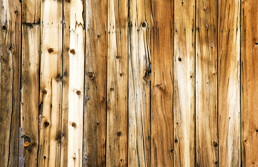 wood wooden plank wall graphic texture of old store building in Bodie deserted ghost town, California, USA