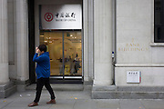 A  Chinese lady walks past the Bank of China in the City of London, Great Britain Uk