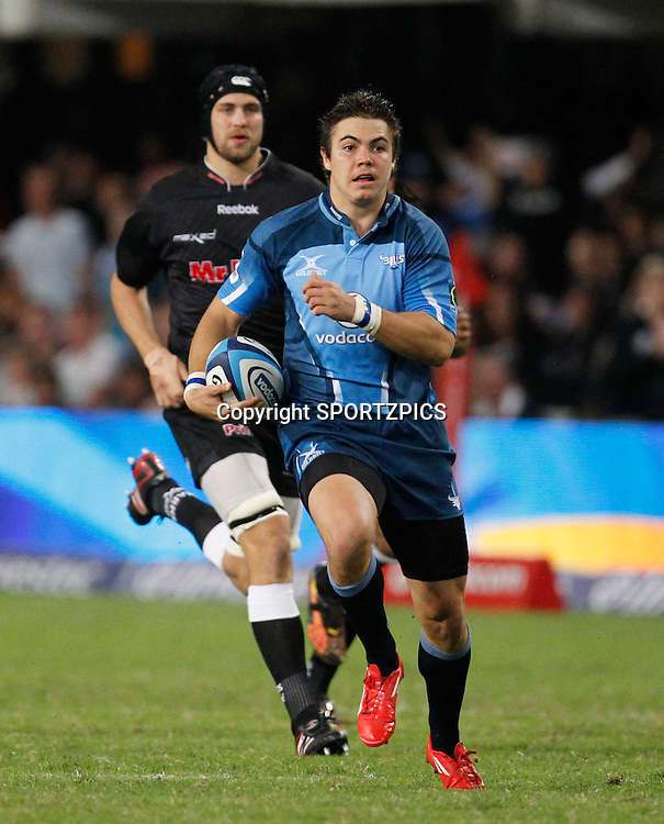 Gerhard van der Heever runs with the ball during the Super 15 match between the Sharks and the Bulls played in Durban on the 21 May 2011..Photo by: SPORTZPICS