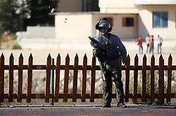 16.10.2015, Ramallah, PSE, Gewalt zwischen Palästinensern und Israelis, im Bild Zusammenstösse zwischen Palästinensischen Demonstranten und Israelischen Sicherheitskräfte // A member of Israeli security forces fires tear gas towards Palestinian protesters during clashes near the Beit El settlement on the outskirts of Ramallah in the West Bank. The unrest that has engulfed Jerusalem and the occupied West Bank, the most serious in years, has claimed the lives of 34 Palestinians and seven Israelis. The tension has been triggered in part by Palestinians' anger over what they see as increased Jewish encroachment on Jerusalem's al-Aqsa mosque compound, Palestine on 2015/10/16. EXPA Pictures © 2015, PhotoCredit: EXPA/ APAimages/ Shadi Hatem<br /> <br /> *****ATTENTION - for AUT, GER, SUI, ITA, POL, CRO, SRB only*****