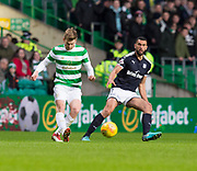 4th April 2018, Celtic Park, Glasgow, Scotland; Scottish Premier League football, Celtic versus Dundee; Stuart Armstrong of Celtic and Steven Caulker of Dundee