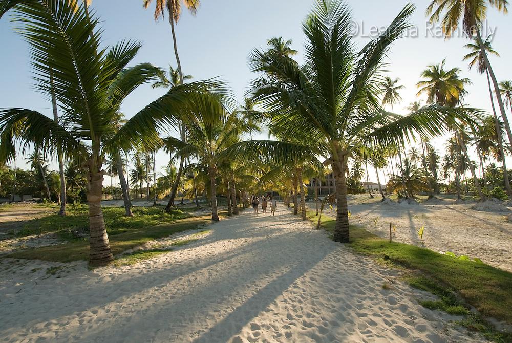 Teenage girl walks the white sand of Bavaro Beach, near Punta Cana, Dominican Republic.