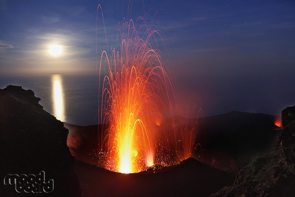 Stromboli Volcano  Strombolian Eruption with Moon behind  Italy  Sicily