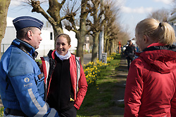 Cecilie Uttrup Ludwig chats with the local constabulary at Dwars door Vlaanderen 2017. A 114 km road race on March 22nd 2017, from Tielt to Waregem, Belgium. (Photo by Sean Robinson/Velofocus)