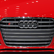 """""""2013 Audi S4 Front Grille""""<br /> <br /> A beautiful image of the front grille, logo, bumper and part of the hood of the awesome Audi S4 in bright red!!<br /> <br /> Cars and their Details by Rachel Cohen"""