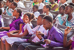 "Bowsky students cross their fingers as they await the announcement of the winners.  Dancing Classrooms Virgin Islands students compete in ""Colors of the Rainbow"" team match competition at Reichhold Center for the Arts.  St. Thomas, USVI.  9 May 2015.  © Aisha-Zakiya Boyd"