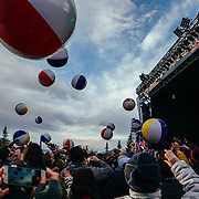 "Micahel Franti and Spearhead perform to a packed crowd in Teton Village, Wyoming. Beach balls bouncing througout the crowd during song ""The Sound of Sunshine""."