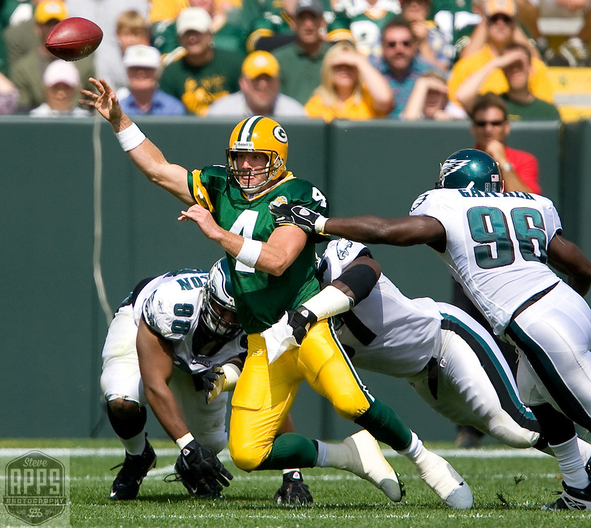 .Green Bay Packers' Brett Favre throws an incomplete pass in the 2nd quarter while pressured by Philadelphia Eagles' Mike Patterson, Brodrick Bunkley, and Omar Gaither..The Green Bay Packers hosted the Philadelphia Eagles Sunday September 9, 2007 at Lambeau Field in Green Bay, Wisconsin. Steve Apps-State Journal.