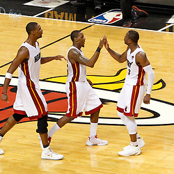 Jun 19, 2012; Miami, FL, USA; Miami Heat power forward Chris Bosh (left) and point guard Mario Chalmers (center) and shooting guard Dwyane Wade (3) celebrate during the fourth quarter in game four in the 2012 NBA Finals against the Oklahoma City Thunder at the American Airlines Arena. Miami won 104-98. Mandatory Credit: Derick E. Hingle-US PRESSWIRE
