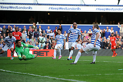 Queens Park Rangers' Richard Dunne scores an Own goal from a Glen Johnson cross - Photo mandatory by-line: Dougie Allward/JMP - Mobile: 07966 386802 - 19/10/2014 - SPORT - football - London - Loftus Road - QPR v Liverpool - Barclays Premier League