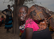 Baby Robert Tikai (in greeen) five months, with Mother in pink blouse Mary Albunu.  attend a mother to mother group at Manyatta Zebra, Isiolo county, Kenya Thursday, Feb. 13, 2014 Mary wants her daughter to be a Doctor when she grows up.She wants him to be a pilot.(Elizabeth Dalziel for Christian Aid)