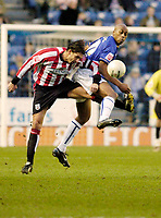 Photo: Leigh Quinnell.<br /> Leicester City v Southampton. The FA Cup. 28/01/2006.<br /> Southamptons Claus Lundekvam clashes in the air with Leicesters Mark De Vries.
