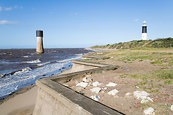 Sea defences and lighthouses at Spurn Head; East Yorkshire; England, On the left is Spurn Low Light; on right is Spurn Lighthouse,