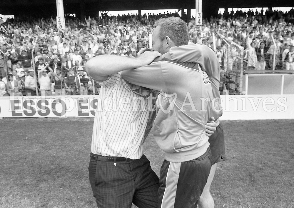 789-796<br /> 1989 Leinster Football Final at Croke Park, 30th July: <br /> Dublin 2-12 Meath 1-10.<br /> Dublin team manager Gerry McCaul on left. Hugs after the win.<br /> Pic: Liam Mulcahy, 30/7/89<br /> (Part of the Independent Newspapers Ireland/NLI Collection)