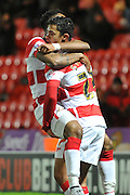 Cameron Stewart of Doncaster Rovers celebrates his gola with Cedric Evina  of Doncaster Rovers  to go 3-0 up  during the Sky Bet League 1 match between Doncaster Rovers and Chesterfield at the Keepmoat Stadium, Doncaster, England on 24 November 2015. Photo by Ian Lyall.