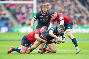 Stuart McInally (#2) of Edinburgh Rugby is tackled by Dave Kilcoyne (#1) of Munster Rugby during the Heineken Champions Cup quarter-final match between Edinburgh Rugby and Munster Rugby at BT Murrayfield Stadium, Edinburgh, Scotland on 30 March 2019.