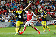 Fleetwood's Chris Long goes in with Oxford's Aaron Martin  during the EFL Sky Bet League 1 match between Fleetwood Town and Oxford United at the Highbury Stadium, Fleetwood, England on 17 August 2016. Photo by Craig Galloway.