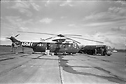 26/06/1963<br /> 06/26/1963<br /> 26 June 1963<br /> Irish Shell and BP fuel tankers for the helicopters of President John F. Kennedy under guard at Dublin Airport. View of one of the helicopters, a U.S. Army  Sikorsky VH-3A Sea King, s/n 150613, being refuelled by a Shell and BP Leyland tanker.