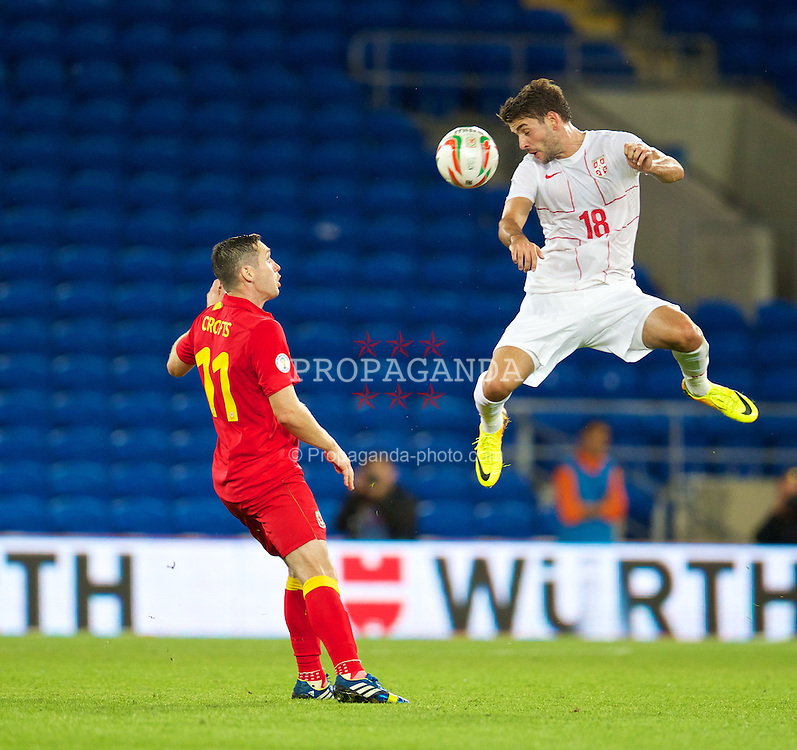 CARDIFF, WALES - Tuesday, September 10, 2013: Serbia's Filip Djordjevic in action against Wales during the 2014 FIFA World Cup Brazil Qualifying Group A match at the Cardiff CIty Stadium. (Pic by David Rawcliffe/Propaganda)