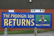 Sign outside of the Cherry Red Records Stadium welcoming Wally Downes as the new managerduring the EFL Sky Bet League 1 match between AFC Wimbledon and Rochdale at the Cherry Red Records Stadium, Kingston, England on 8 December 2018.