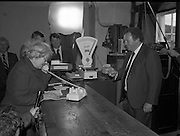 Opening of Automatic Telephone Exchanges, Aran Mor..1980-06-20.20th June 1980.20/06/1980.06-20-80..Minister of State at the Department of Posts and Telegraphs, Mark Killilea, opens the new automatic exchange at Kilronan on Inismore. ..He looks on as Máire Bn. Nic Giolla Phádraig, Postmistress Kilronan, calls her relations in the United States.