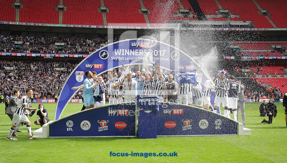 Millwall players celebrate after winning the Sky Bet League 1 play-off final at Wembley Stadium, London<br /> Picture by Glenn Sparkes/Focus Images Ltd 07939664067<br /> 20/05/2017