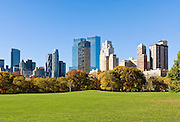 Central Park, New York City in Autumn looking towards the Central Park South Skyline and The Time Warner Center from Sheep Meadow.