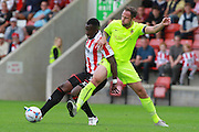 Amari Morgan-Smith and Luke Foster during the Vanarama National League match between Cheltenham Town and Southport at Whaddon Road, Cheltenham, England on 15 August 2015. Photo by Antony Thompson.